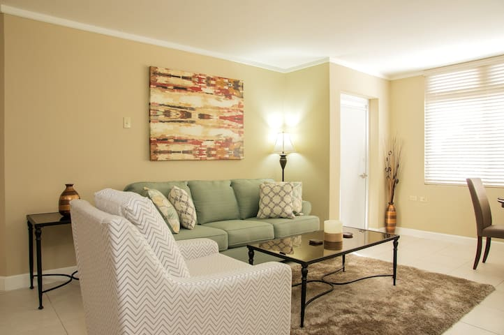 Our luxury 2 bedroom rental property - Smile Orange welcomes you! Ahhh! Our newly renovated beautiful, modern, functional living room open layout