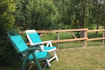 Top up your tan in the sheltered private garden surrounded by mature trees.