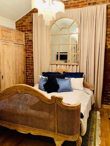 Main Bedroom complete with king size bed, Netflix television and wardrobe. The room has French doors opening to the private garden.