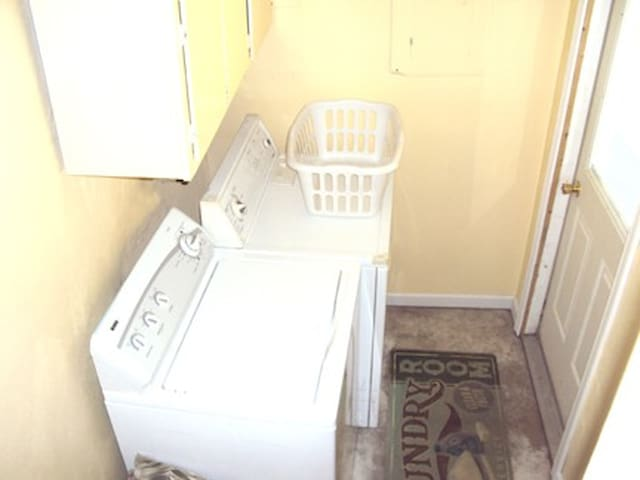 Laundry room has washer & dryer.  It is off the dining rm. The door you see goes to your back yard.