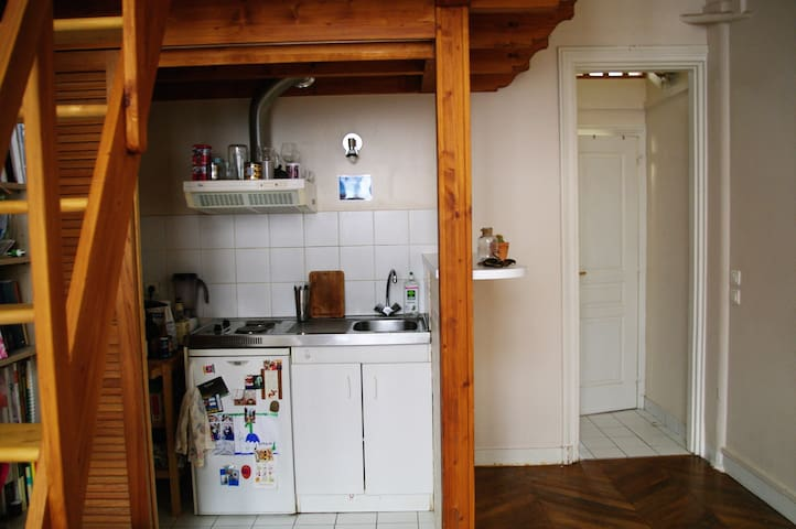 Kitchenette with fridge, all utensils and stove top