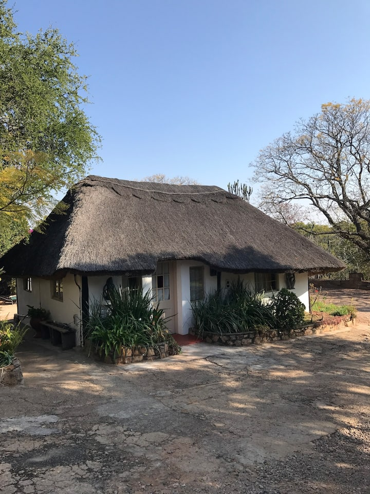 Self contained thatched cottage in lovely gardens.
