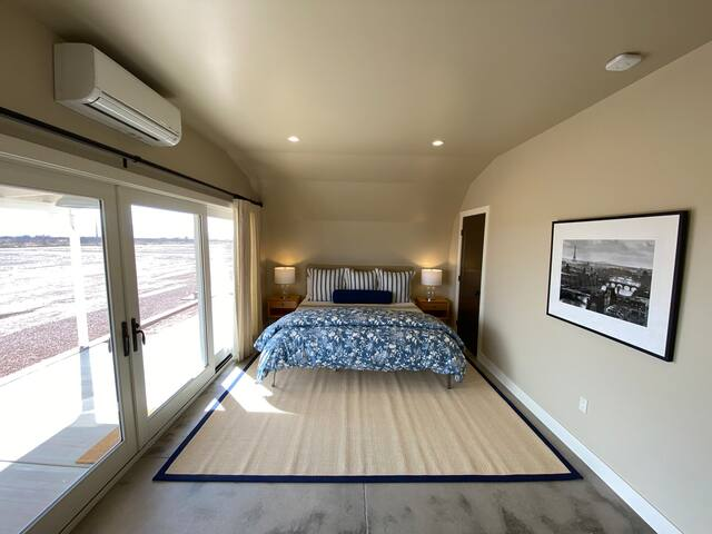 King size bed and 16 ft of glass with sliding doors