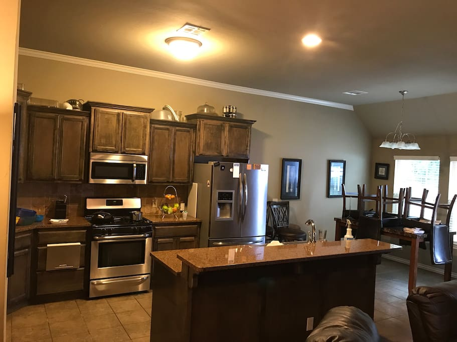 Open Kitchen w all modern amenities w Granite Counter Tops. Kitchen fully stocked with Food Grade Equipment for use during your stay.