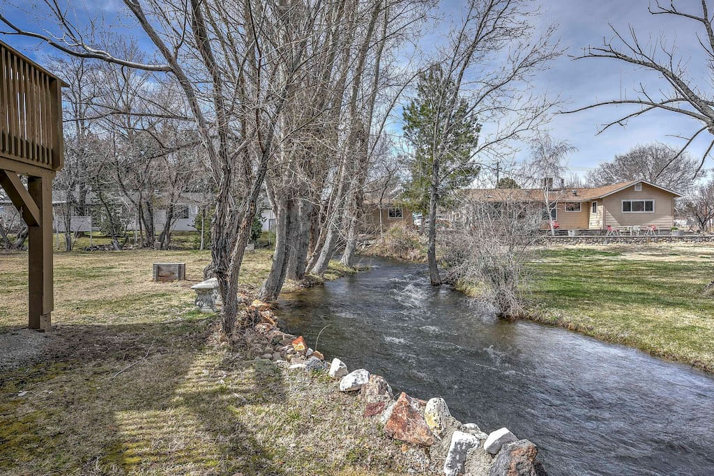 This property features a spacious backyard and a creek that runs throughout the property.