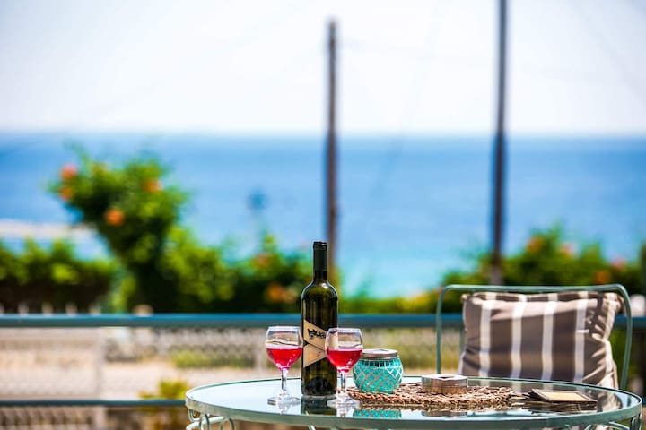 Indulge a relaxing drink with the views of the Greek sea from the comfort of your own verandah.