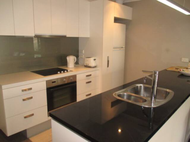 Stylish kitchen with full amenities