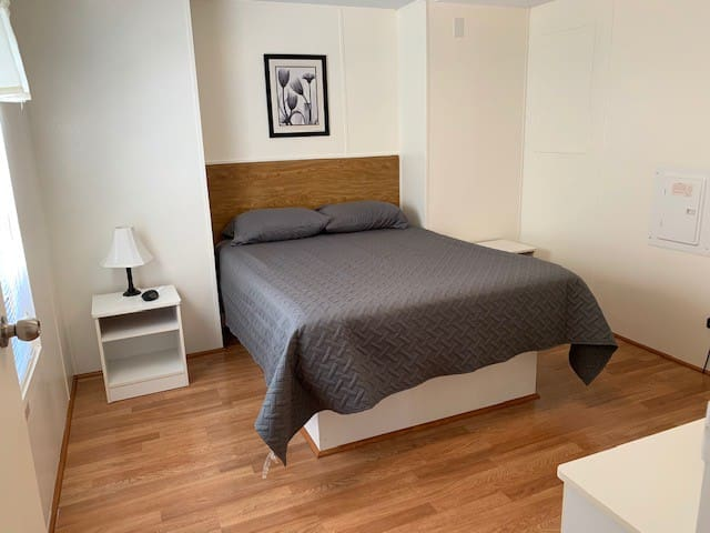 Large Bedroom with Queen Size Bed, plenty of closet and drawer space.
