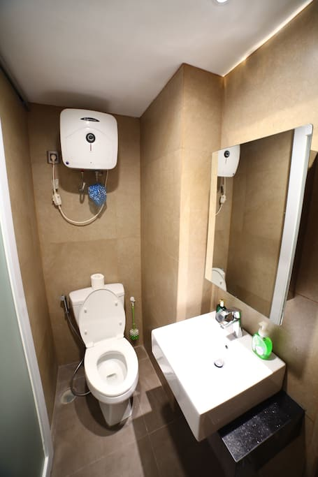 Toilet, water heater, mirror and sink