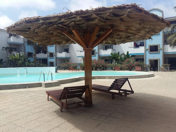 Room in residential area with pool + beach + WIFI