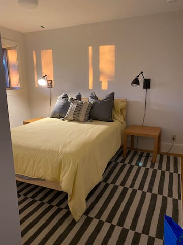 First-floor bedroom with full-size bed