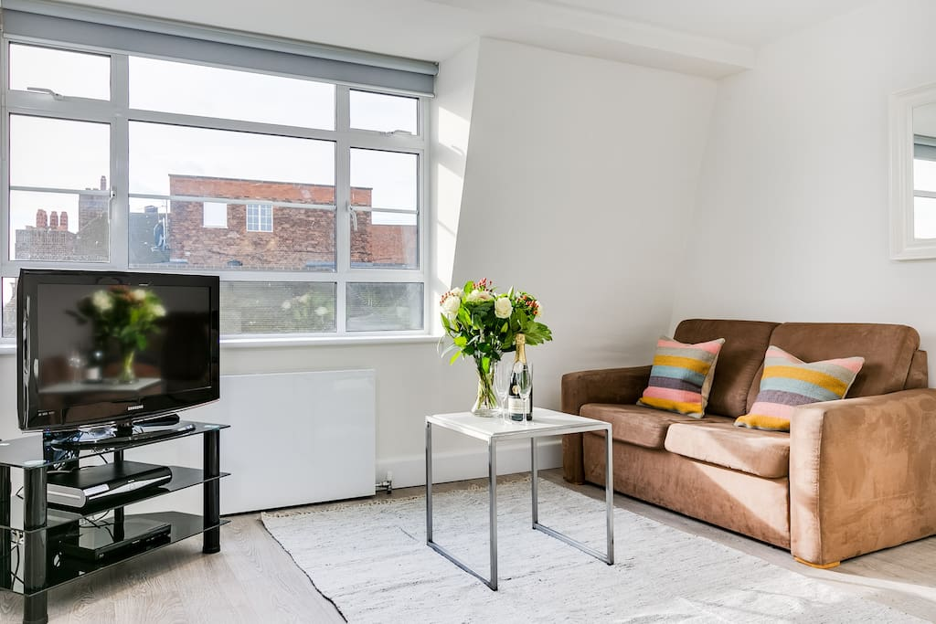 Comfy living area with free fast wifi, freeview TV and city views