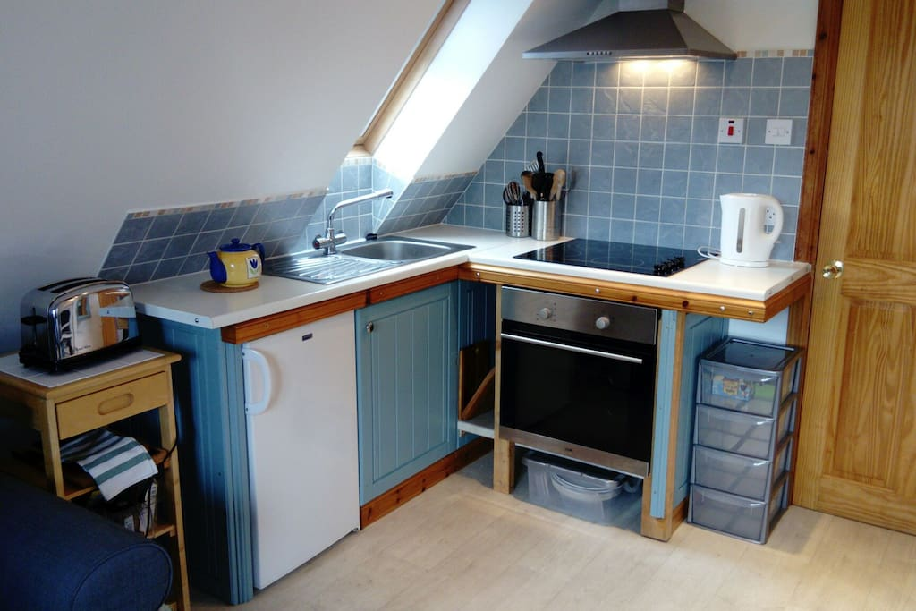Full size kitchen, with everything you need - microwave oven, toaster, pots and dishes, etc.