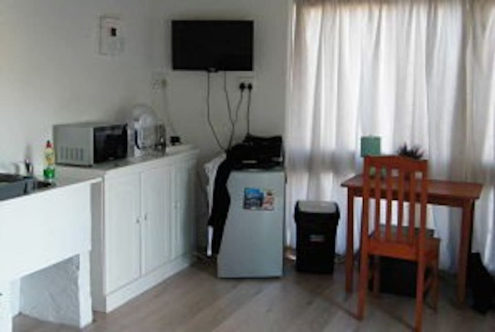 All the amenities for self catering, includes microwave, fridge, cutlery, crockery, kettle and toaster and a sink.