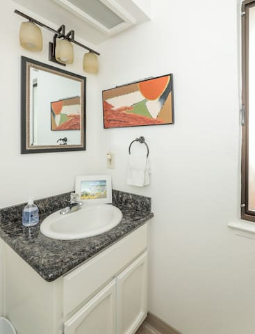 Half bath with granite counter, newer toilet.