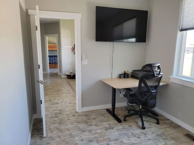 Office/TV room includes an adjustable height desk and chair and printer. A queen sleeper sofa. Netflix and Disney+ available on all TV's.