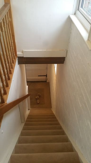Staircase down to front door