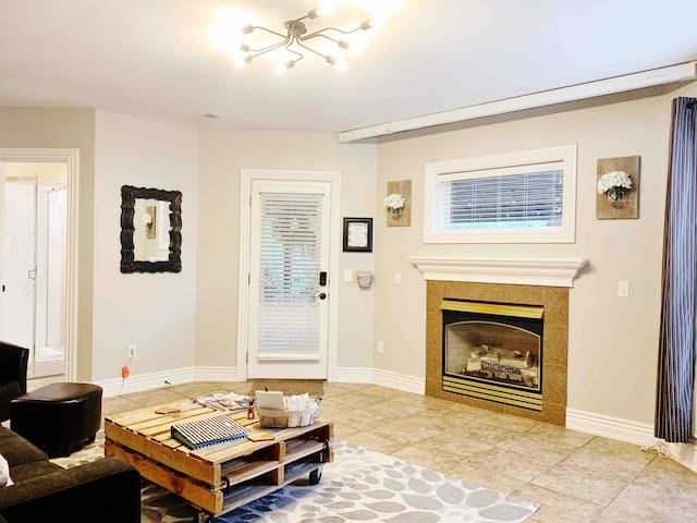 A gas fireplace anchors your living space with patio access and lots of natural light.
