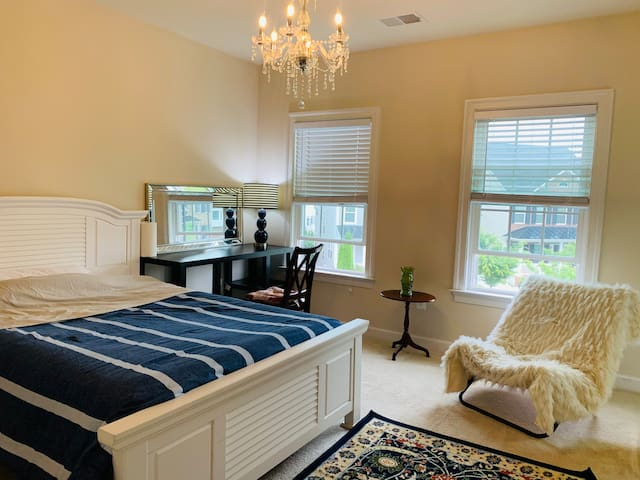 Rose - Queen size bed , walk in closet , desk , night stand , chair  - private bathroom with bathtub and two sinks .