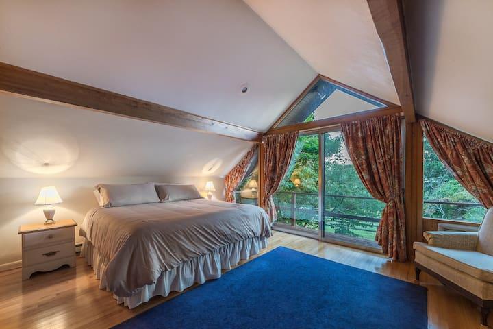 Upstairs king bedroom with balcony