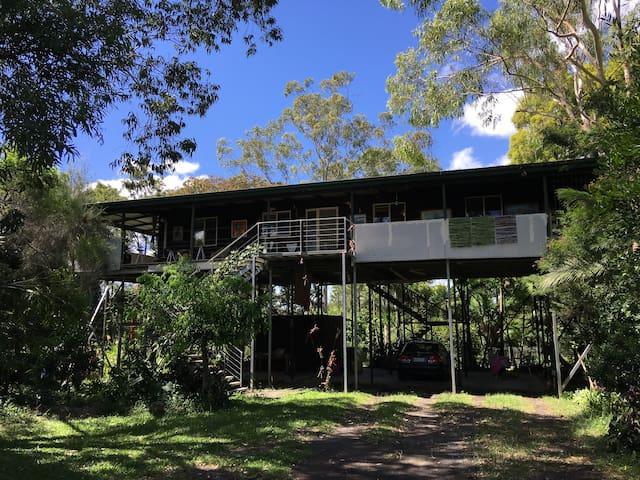 Airy house on stilts, with large, breezy verandah.