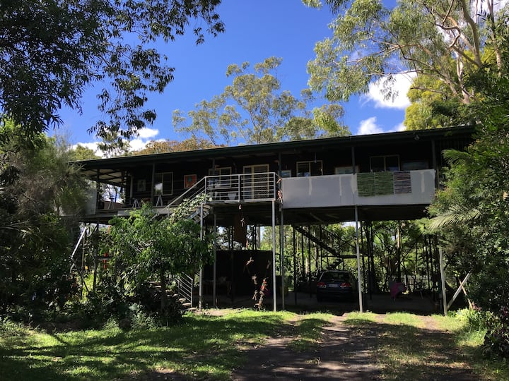 Airy house on stilts, with large, breezy verandah.