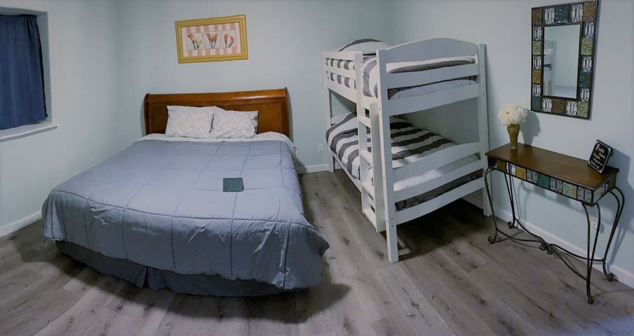 Bedroom with king bed, bunk bed, closet, and mirror.  Room for pack-n-play (available upon request).