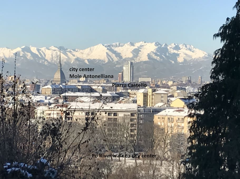 view  of mountains and city center