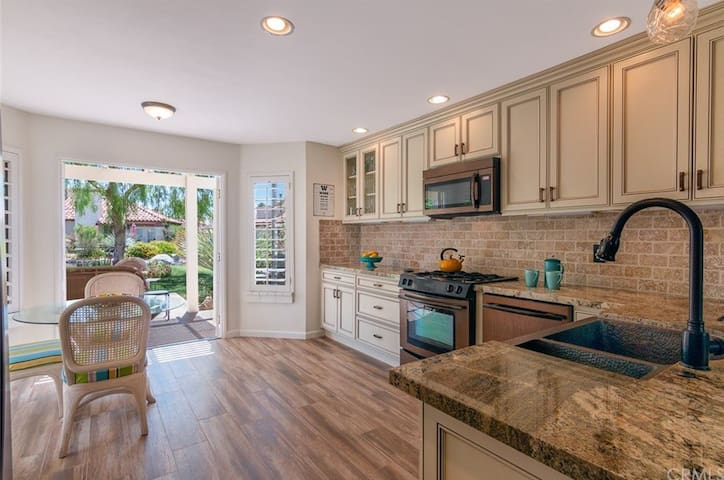 Newly renovated kitchen with french doors leading out to patio