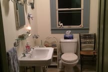 Upstairs recently remodeled bathroom.  Original Quaker built-in shelves and drawers.  New tiling and stone floor.  Additional photos on other listings.