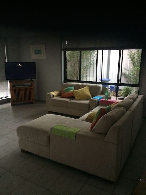 Family room overlooks the pool with good size kitchen and kitchen table nearby