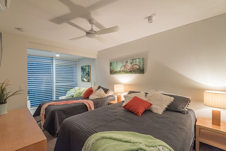 Second bedroom. Queen and king single bed. Sunroom and Air Conditioning