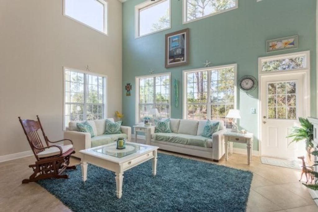 Open concept living room with wall of windows to let the Florida Sunshine in!