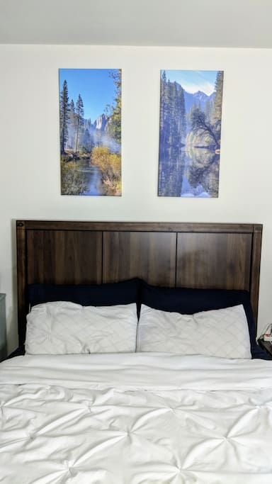 Bed frame with Yosemite wall art
