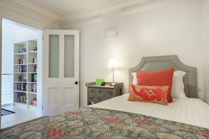 The third bedroom is reached via the staircase in the second bedroom. This sweet room offers a king single bed, with the option to also make use of a very comfortable trundle bed which rolls out easily from underneath the bed (upon request).