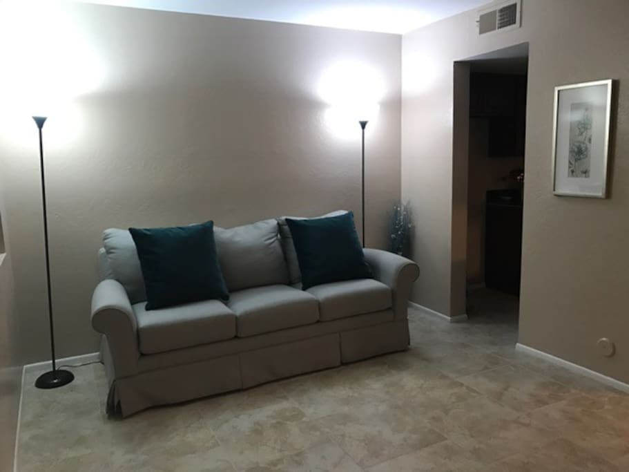 Front room with a pull out bed memory foam mattress with extra pillows.