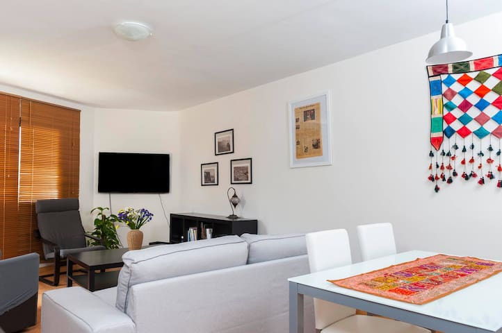 The living room is ideal for resting, reading, watching TV, chatting, eating or ... taking a nap