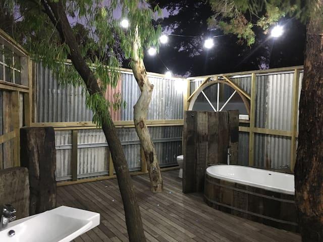 Outdoor Bathroom at twilight