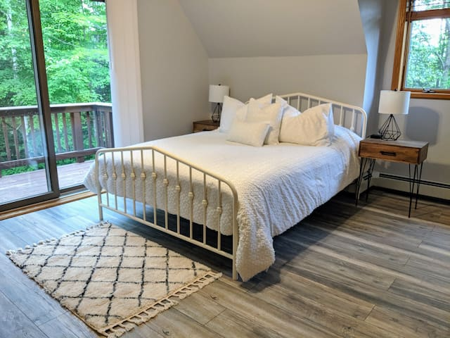 Bedroom #2 - Queen sized memory foam bed, deck overlooking the river, smart TV, his and hers closets, located upstairs, sahres a bathroom with Bedroom #1