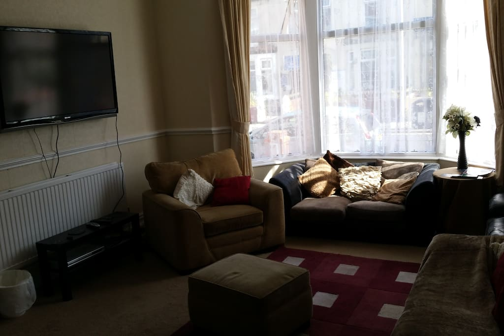 lovely big guest lounge with lots of settees to relax on