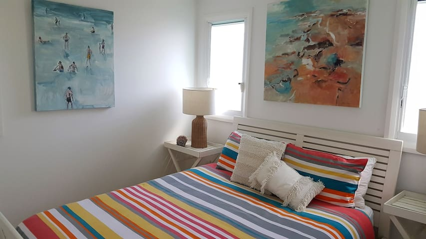 Beautiful main bedroom with QS bed