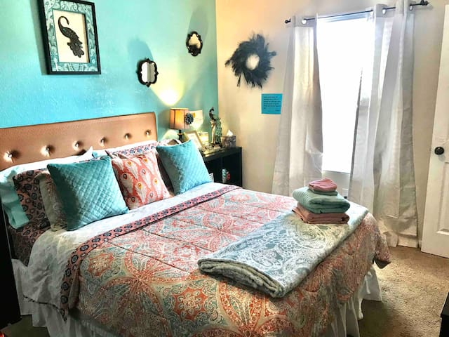 Enjoy tons of pillows and extra blankets in this bright and cheery room! Room darkening curtains for those that sleep in!