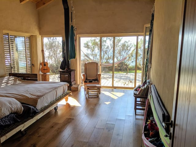 Master bedroom, with fire place, 3m on 2m bed, an oak floor (not heated) and the best sea view.