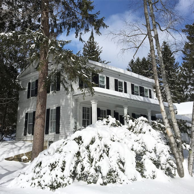 side view of house in winter