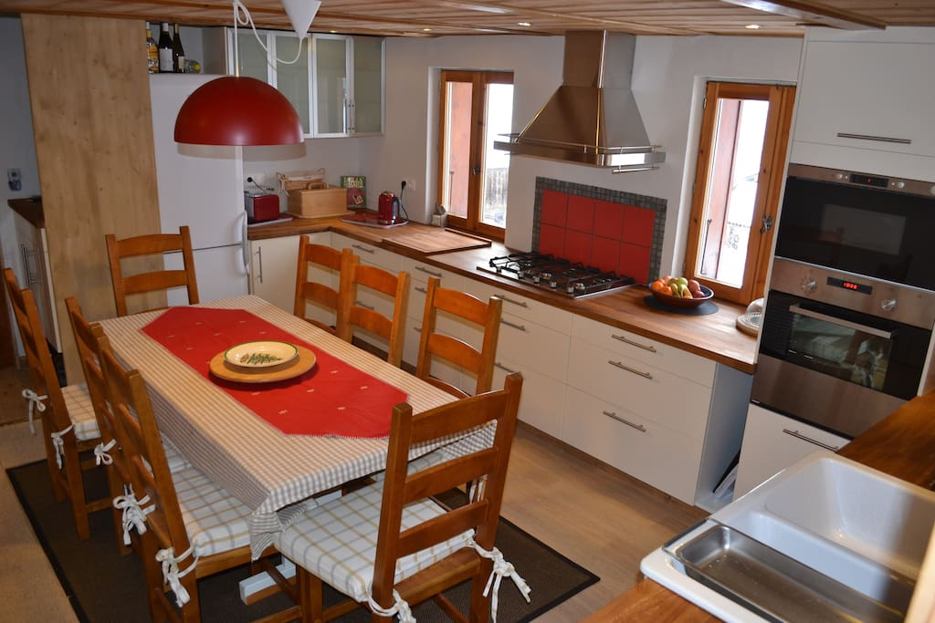 Upper kitchen seats eight, fully equipped with modern appliances including dishwasher