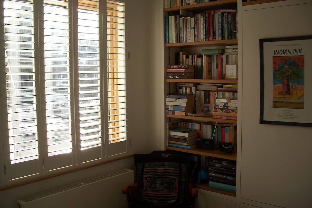 Large window in bedroom; plenty of reading material to browse through!