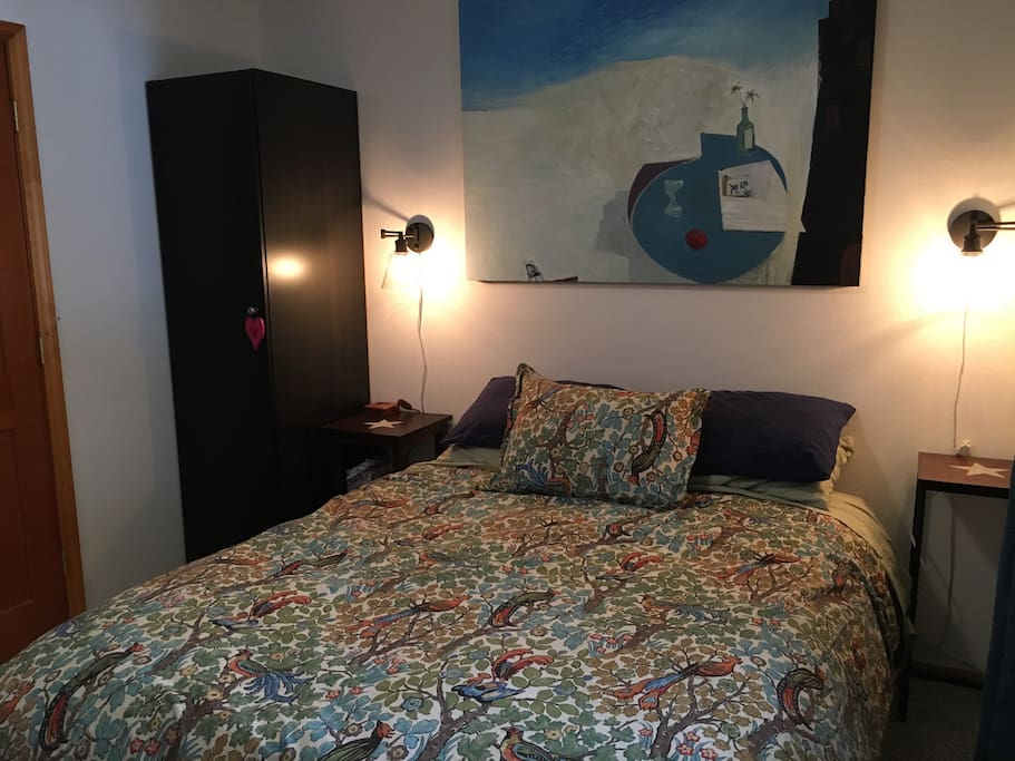 Soft top queen bed in small guest room. Down comforter or quilt with extra blanket and pillows. Games in the cabinet.