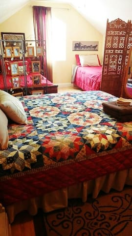 We started calling this room the Cowboy room after finding these fun pictures and coverlets.
