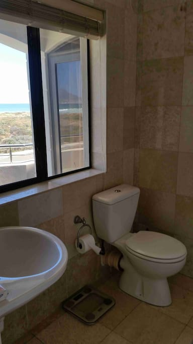 En-suite bathroom with bath, toilet and basin, with a view!