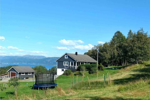 Charming farmhouse and boat by fjord near Bergen